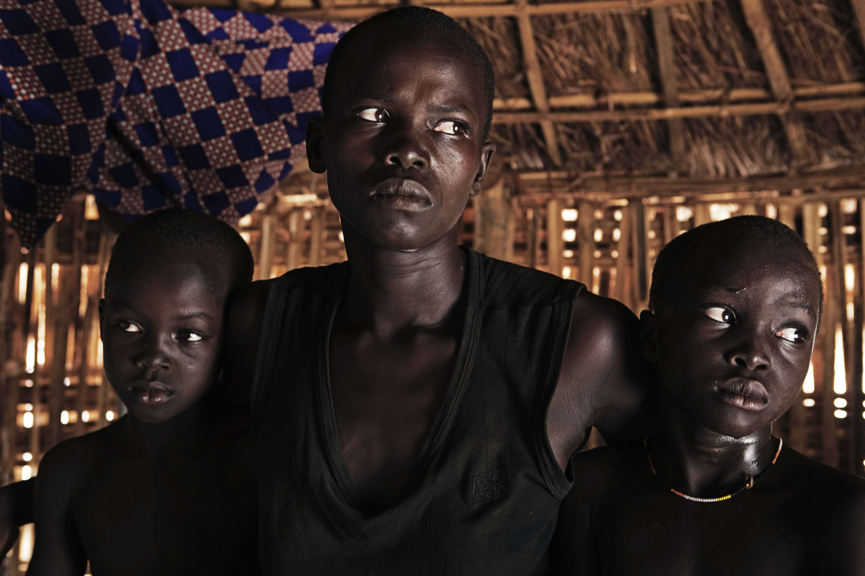 The Nyi-Bo family sits in a bamboo hut in the remote village Dongoi in Sudan. The family is a part of the indigenous tribe Jur. The patriarch of the family ...