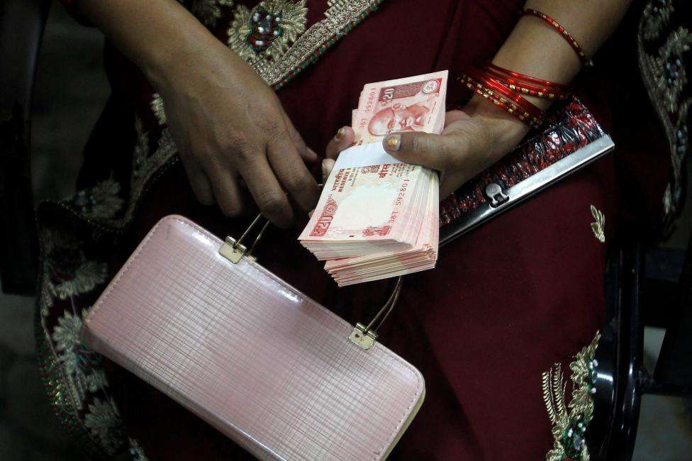 Withdrawal from Jan Dhan accounts cut to Rs 10000 a month