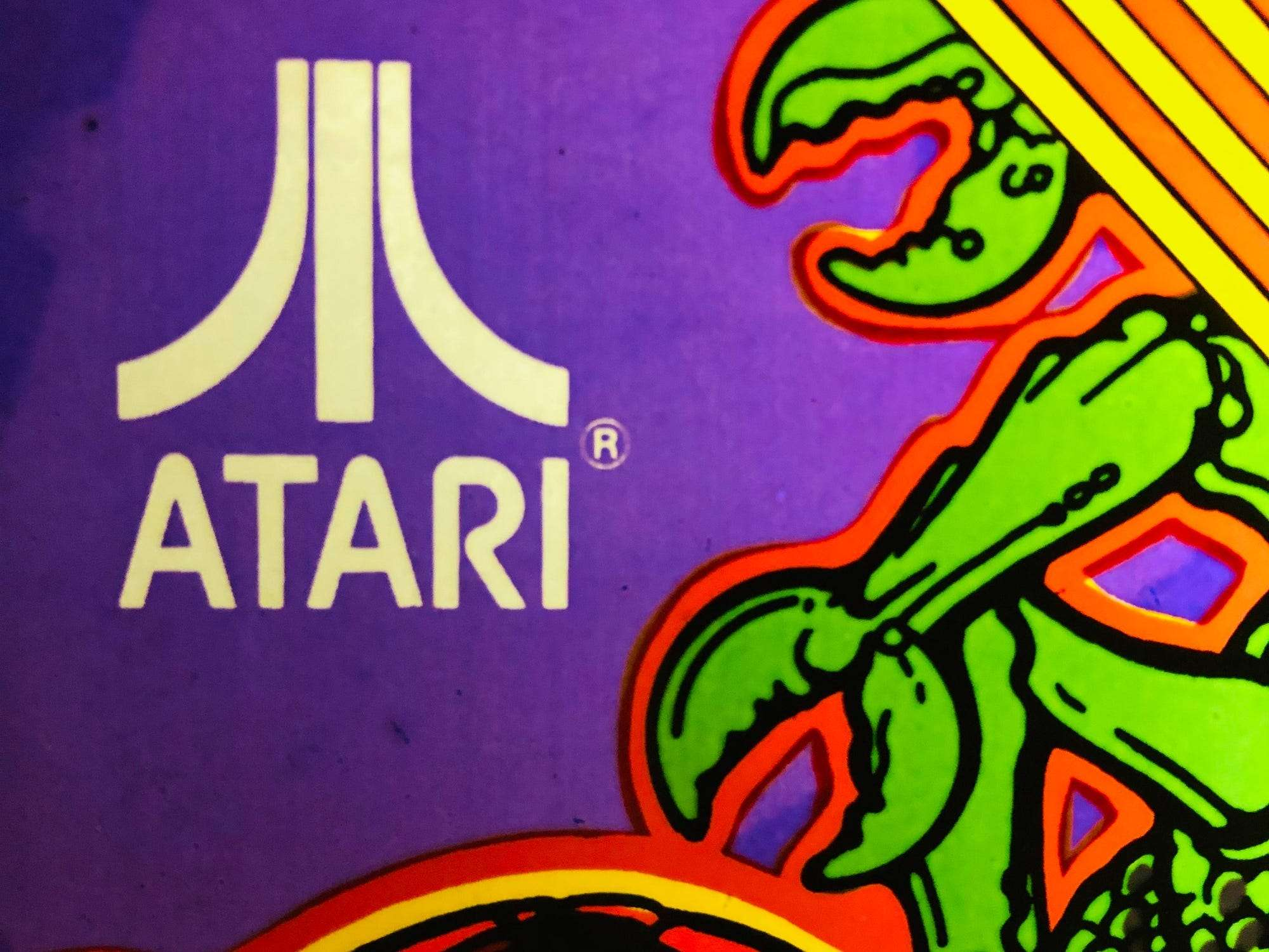 Atari is auctioning off a full-sized vintage 'Centipede' arcade set, along with digital memorabilia