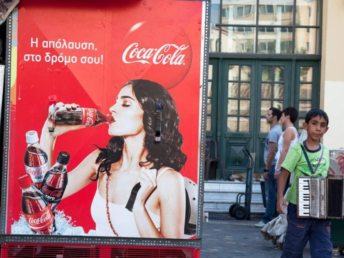 Coca-Cola is sold in all but 2 countries on Earth. Here's what their ads look like around the world.