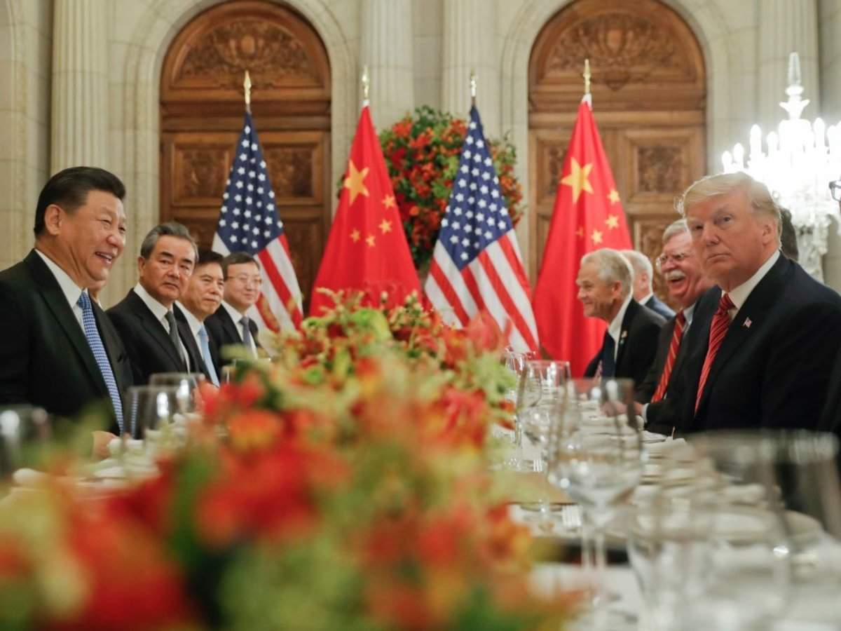 Stocks slide as China cancels US farmer visit