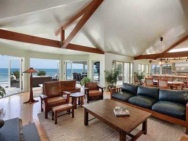 One of his Malibu homes, a 2,800-square-foot oceanfront cottage, is available to rent for $65,000 a month this summer.