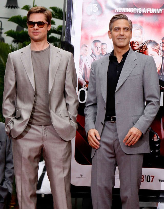 Don't listen to GQ - George Clooney is still incredibly stylish and these 15 photos prove it He-always-steps-it-up-when-hes-being-photographed-next-to-brad-pitt-