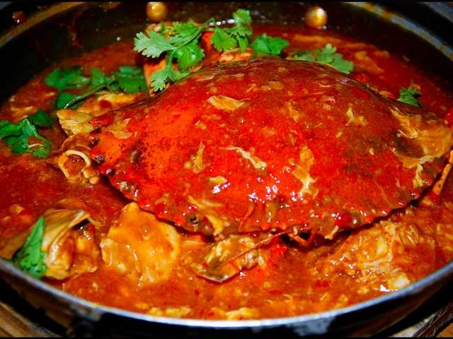 Try chili crab — crabs that are boiled and stir-fried in a semi-thick delectable tomato and chili sauce.