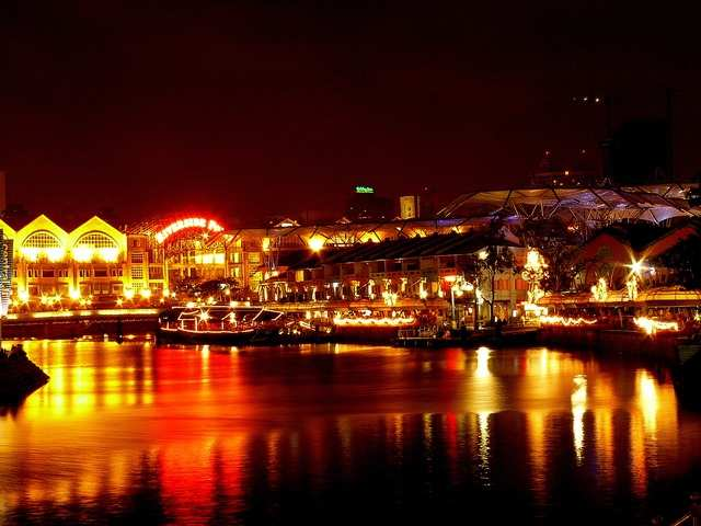 Stroll along Clarke Quay at night, a historical riverside quay that's filled with restaurants, bars, and fun entertainment venues where you can practice your karaoke.