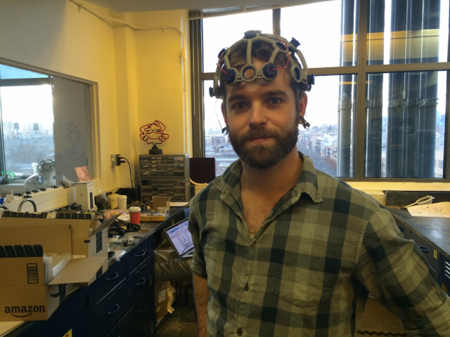 I controlled a robot arm with my brain, using this high-tech headset