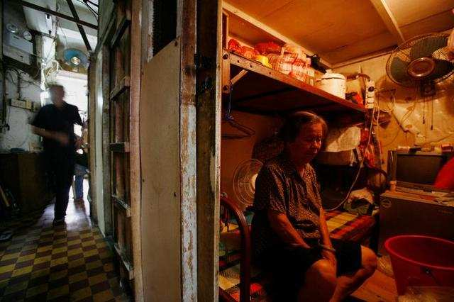 """Inside a 600-square-foot apartment complex in Hong Kong sit 19 units, all measuring less than 25 square feet. They are known as """"cubicle homes."""" Or, more ominously, """"coffin homes."""""""