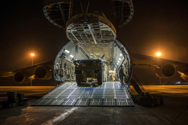 Over 266,000 pounds of cargo and armored vehicles are loaded into a C-5 in Afghanistan.