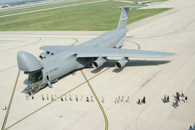 The C-5 Galaxy absolutely dwarfs humans.