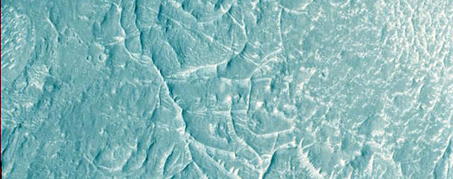Ridges cross the Nepenthes Mensae region, which is often referred to as a river delta for the striking pattern.
