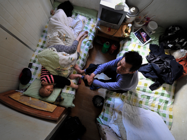 In the Chinese city of Hefei, patients who can't afford a bed at the local hospital are forced to receive treatment in one of the 86-square-foot rooms in a nearby apartment building.