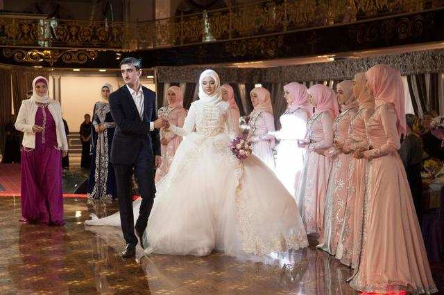 In Chechnya a dress code that emphasizes modesty is strictly enforced. Brides wear white gowns that cover them head to toe. Metal fasteners adorn outfit's bust, and a silver belt — an heirloom passed down from mother to daughter — hangs on the waist.