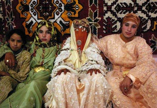 The Moroccan bride puts on a show with three wardrobe changes. For the reception, she trades a white kaftan, or robe, for an outfit that reflects the culture of her family's region.