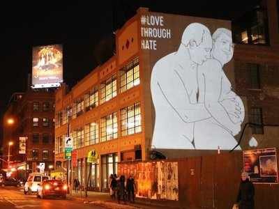 Someone projected a giant image of Putin caressing a pregnant Trump on a New York Apple store