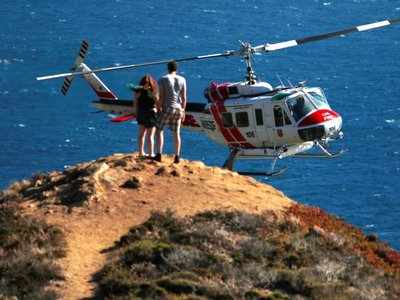 Guests at California's ritziest self-help retreat center have to be airlifted out by helicopter because of storms