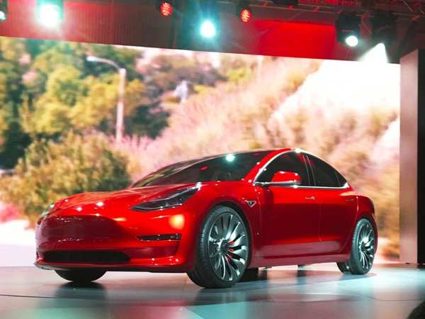 Elon Musk shows Tesla Model 3 in near production form
