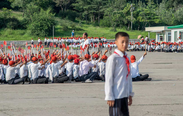 The tourism bureau encourages visitors to take photos of student-exercise groups. These kids rehearsed for a celebration of the 70th anniversary of the Workers' Party of Korea.