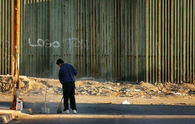 The American government began building corrugated steel walls stretching eight to 10 feet tall in the early '90s.
