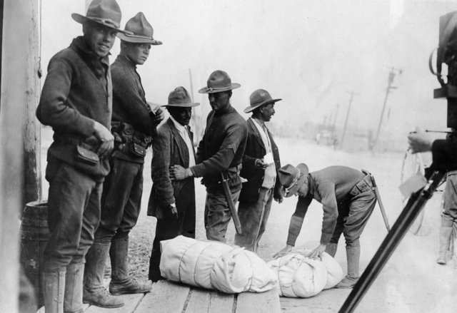 The US established an official border patrol in 1924 with the goal of securing the US-Mexico border. In the photo below, American guards are patting down Mexicans who wish to enter the US.