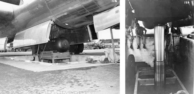 """Using the hydraulic lift, """"Little Boy"""" is carefully raised and loaded into the belly of the Enola Gay."""