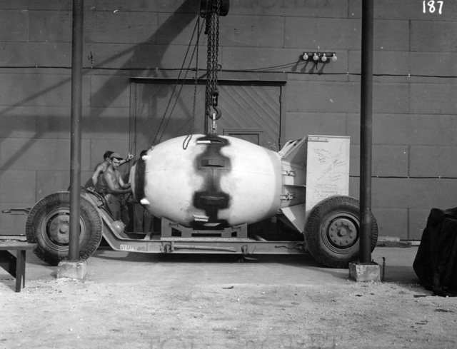 """""""Fat Man"""" is loaded onto a transport trailer and given a final once-over."""