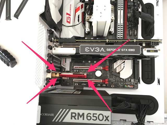 The WiFi card fits underneath the graphics card.