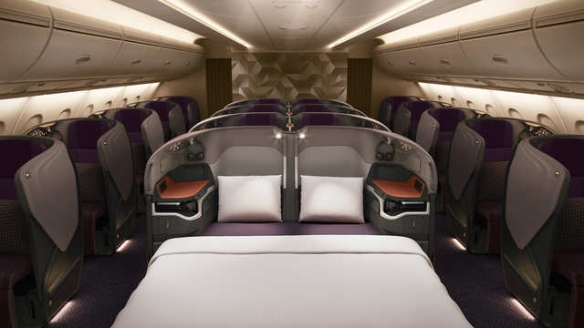 The business class seats along the center of the aircraft can be connected to form a single bed. Great for families traveling together. Passengers also get an 18-inch entertainment screen.