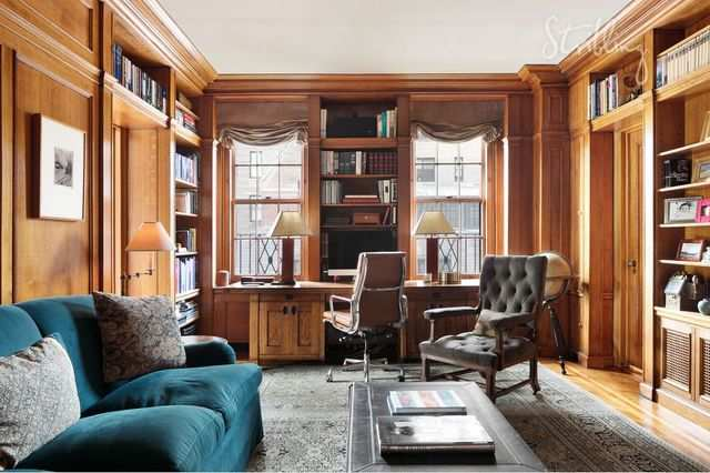The wood-paneled library is sure to be a favorite of any book lovers.