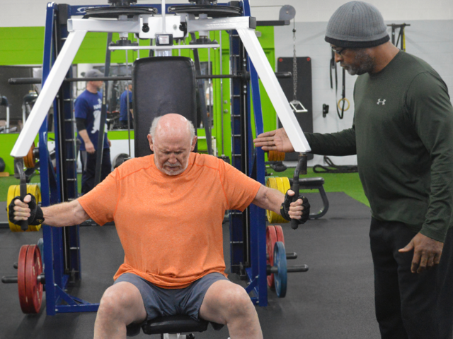 Caballero does a combination of strength and cardio exercises with his trainer, John.