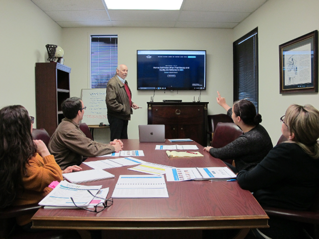 Caballero meets with some other team members at 3:30 to review the company's website. In addition to version two of the platform, the public website is getting redesigned. Caballero leads the discussion with the HomesUSA guiding principle: Homes sell faster when their beauty and quality are reflected in MLS.