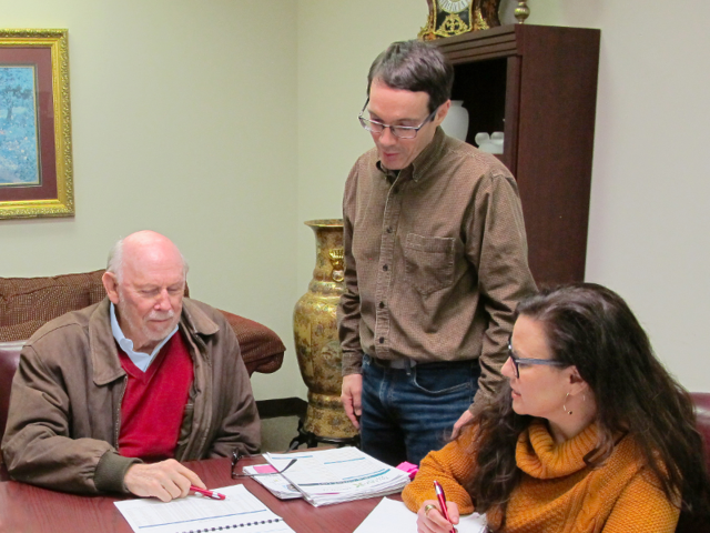 At 2:15, Caballero meets with the MLS project manager, David, and office supervisor and photos manager, Casey, to review progress on the upcoming second version of the HomesUSA.com platform.