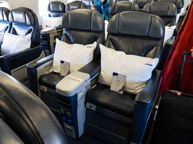 Each Seat Which Could Recline Far Back And Had Foot Leg Rests A Large Pillow Warm Blanket Custom In Flight Menu Waiting On It