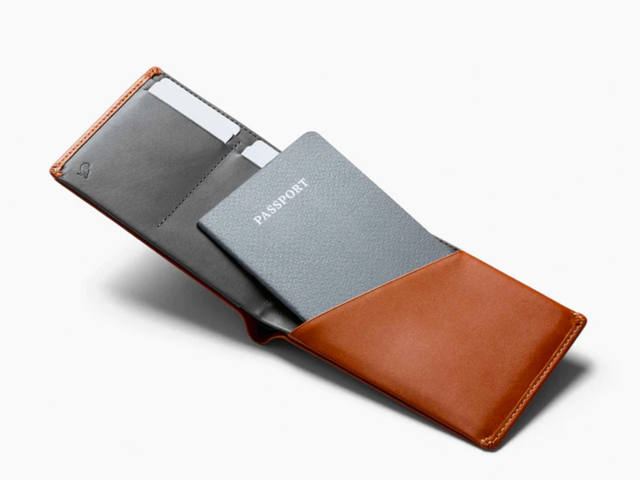 A travel wallet that also holds their passport