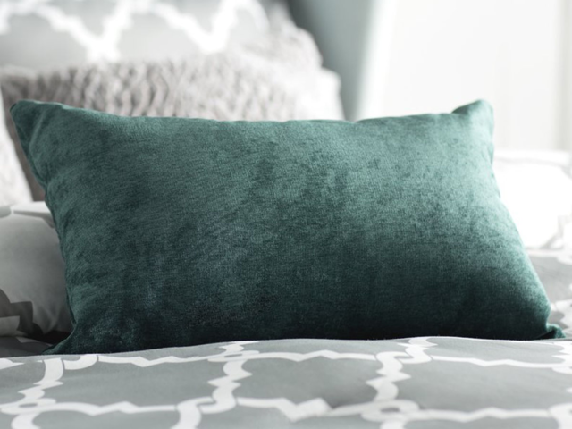 Add a nice bolster pillow to your bed