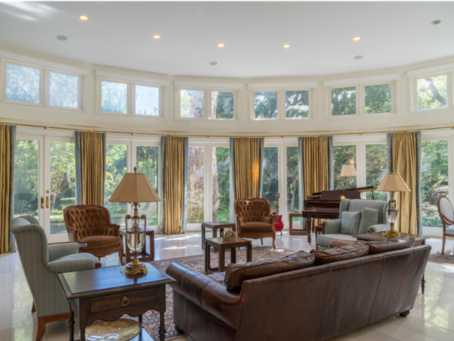 Williams bought the house in 2006 for $6.62 million. Inside are high ceilings with marble and hardwood floors.