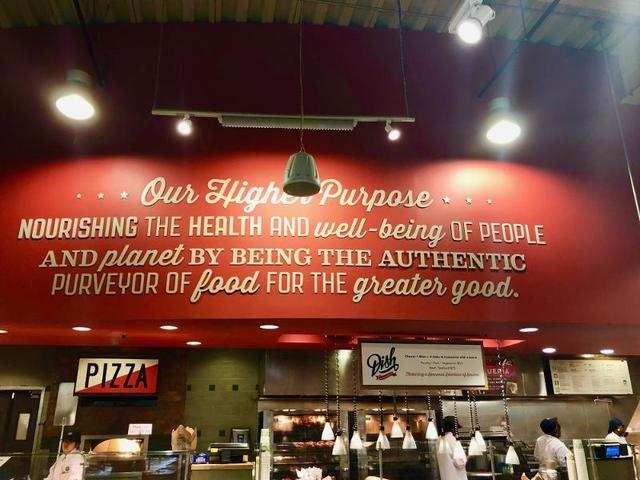 The wall behind one of the food counters reiterated Whole Foods' commitment to health and natural food.