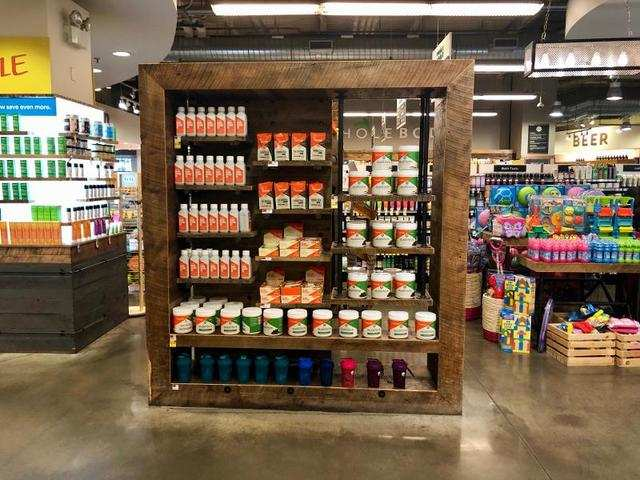 Overall, the entire design of Whole Foods seemed to take a rustic and natural approach, from the shelves with wood finish ...