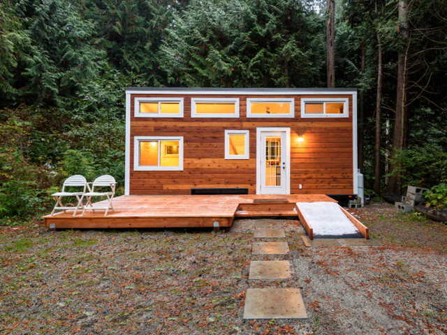 Ryan Mitchell has saved six figures since moving into his tiny house.