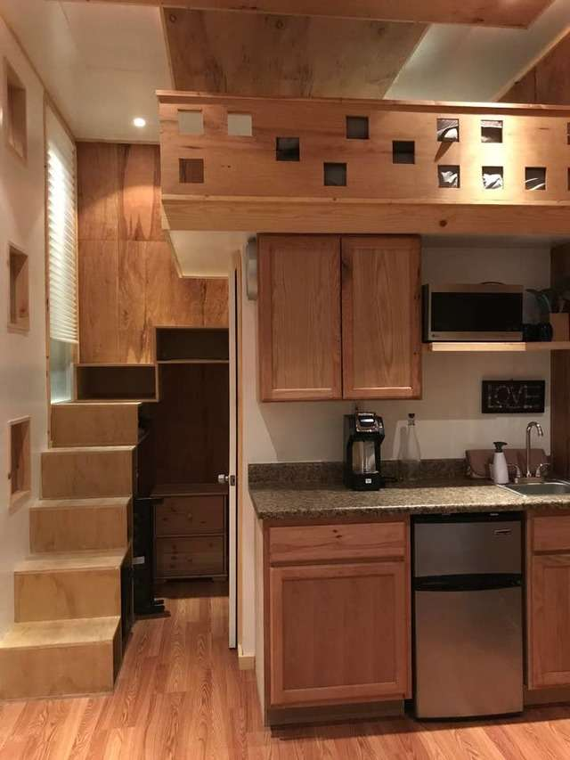 The kitchenette is in the center of the home, with access to the loft and double bed.