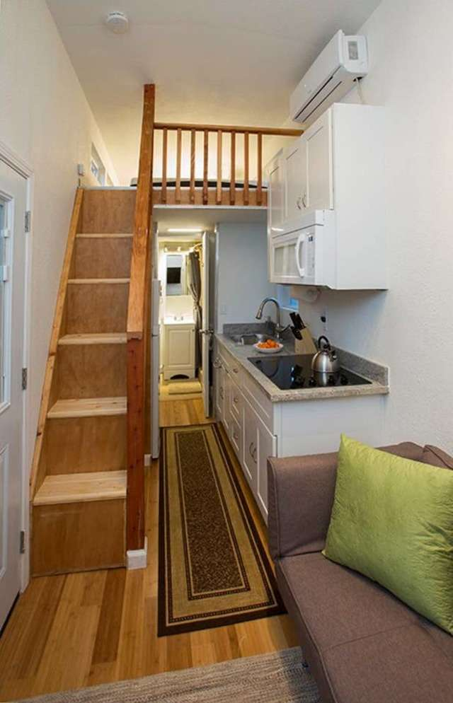 The loft is accessible by stairs, an upgrade from the usual ladders found in tiny houses.