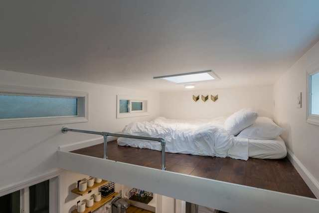 Relax in the sleeping loft, with a queen bed and skylight.
