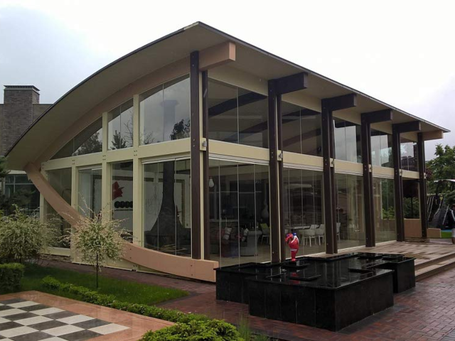Although many of these build-it-yourself tiny homes are pretty simplistic and cookie cutter, there are some listings on Amazon that have more unique looks. This EcoHouseMart Lounge home is uber modern looking with lots of windows — which are not included in the Amazon kit you'd be sent.