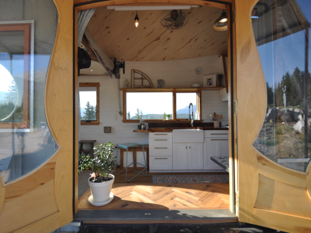 """Parham made his own tiny house """"extra special"""" for trade shows. While he has a knack for macro-decisions, like roof shape and overall floor plan, his wife, Stephanie, has an eye for micro-details."""