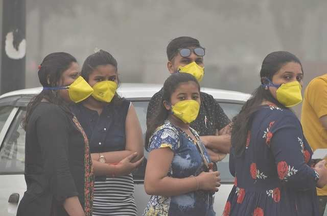 Shocking images of India's national capital Delhi breathing toxic air that is equal to smoking 33 cigarettes a day