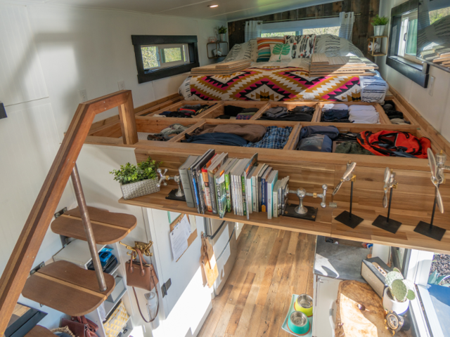 Inside, they find that hidden storage makes the most of a small space — like the floor cubbies surround their king-sized mattress in their sleeping loft.