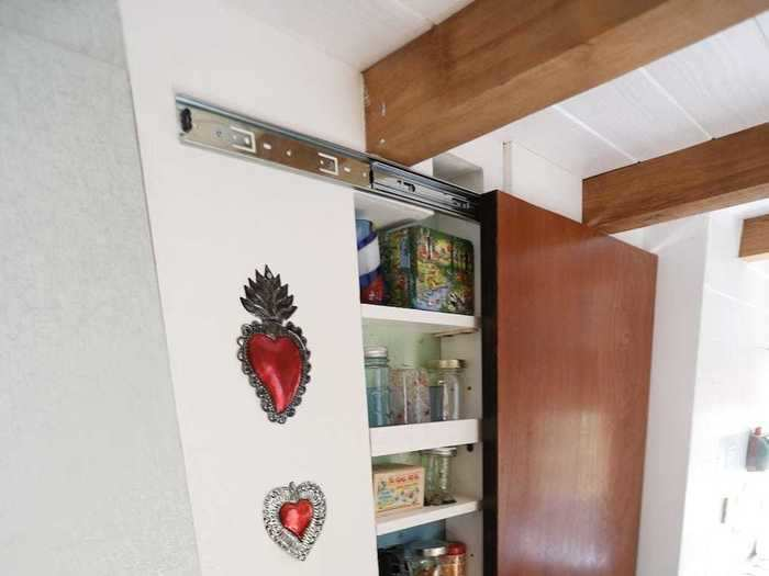 Christian Parsons and Alexis Stephens live in a 130-square-foot tiny house and have a pantry in their kitchen to store some of their food ...
