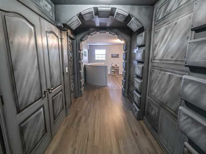 The hallways are decked out like the Millennium Falcon.
