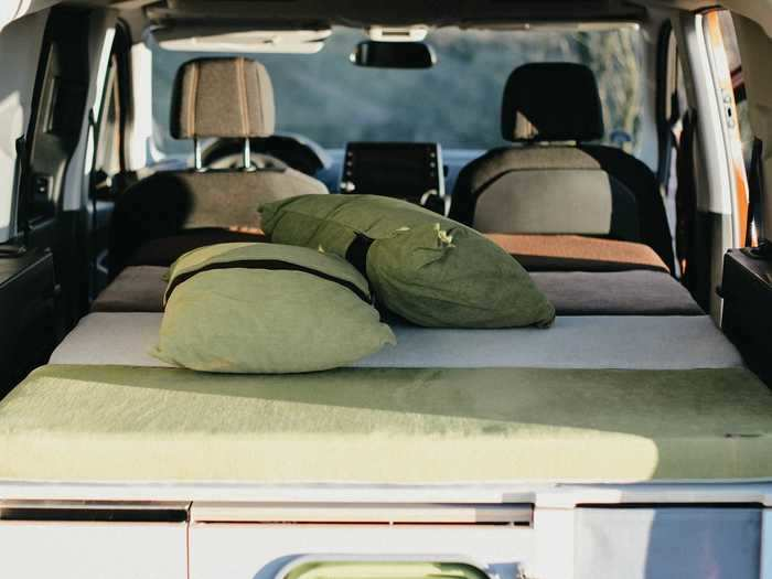 The Camper — which costs up to almost $3,290 — can be used while the second row of seats is up, but when it's bedtime, the trunk and back row can be transformed into a bed that can sleep two.