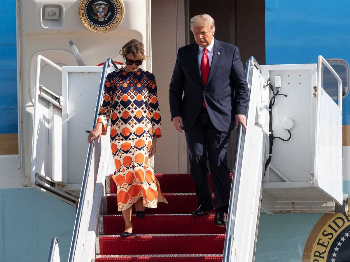 Melania Trump Arrived In Florida Wearing A 3 700 Orange Dress After Leaving The White House In An All Black Look Business Insider India