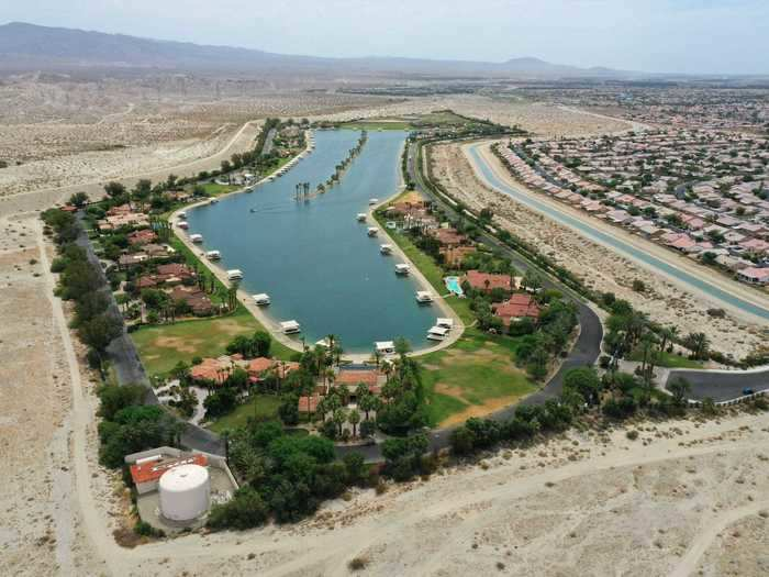 Inside Shadow Lake Estates in Indio, California, an artificial lake glistens despite the scorched landscape surrounding it. Reservoirs and lakes are drying up statewide, with some turning completely to dust with no rain expected until later this year.